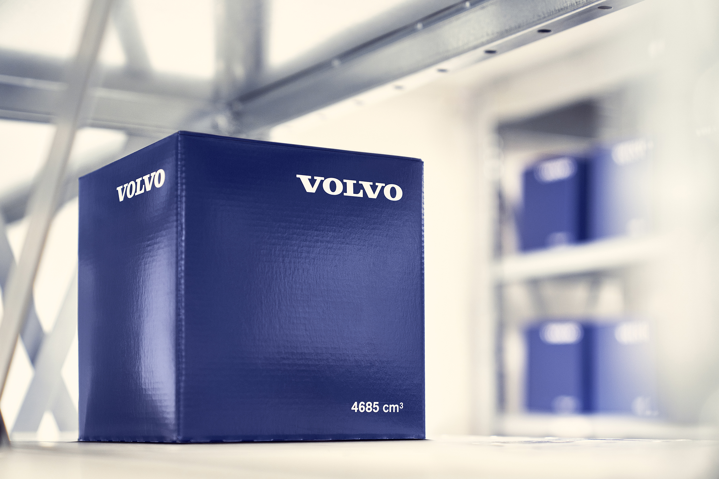 A blue Genuine Volvo Parts box on a shelf